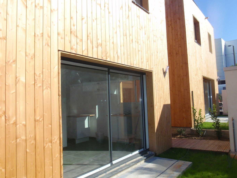 Construction habitat en bande et co quartier modulaire for Construction habitat